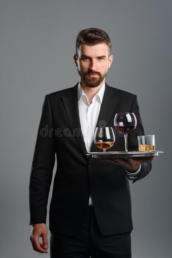 Waiter carrying tray with drinks stock photo