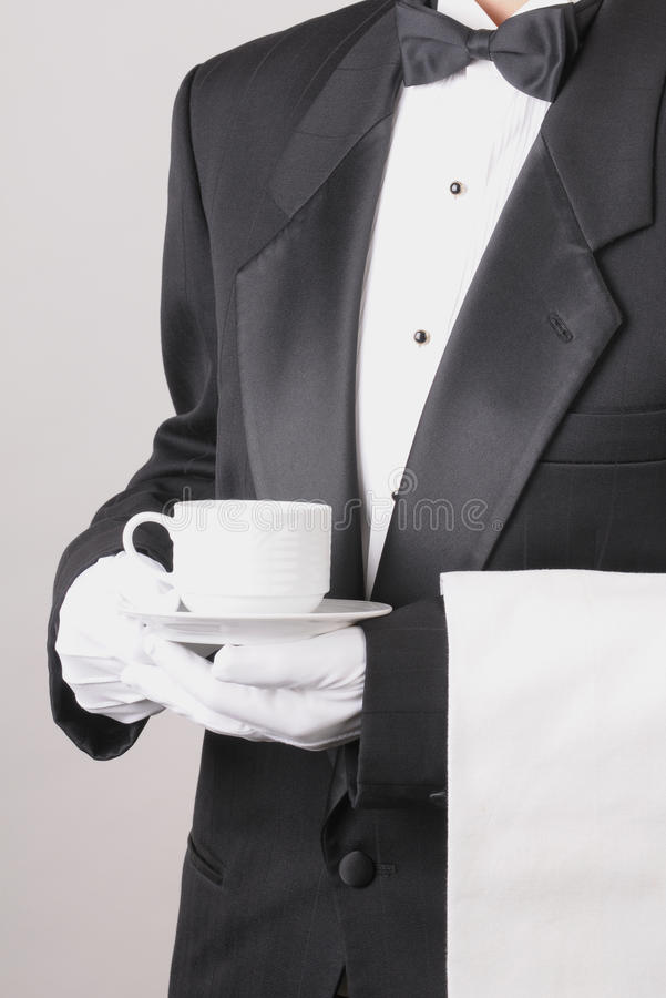 Free Waiter Holding Coffee Cup And Towel Stock Photos - 12388953