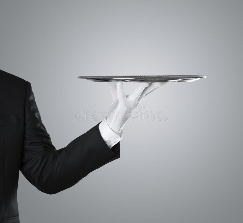 Waiter holding empty silver tray stock photos