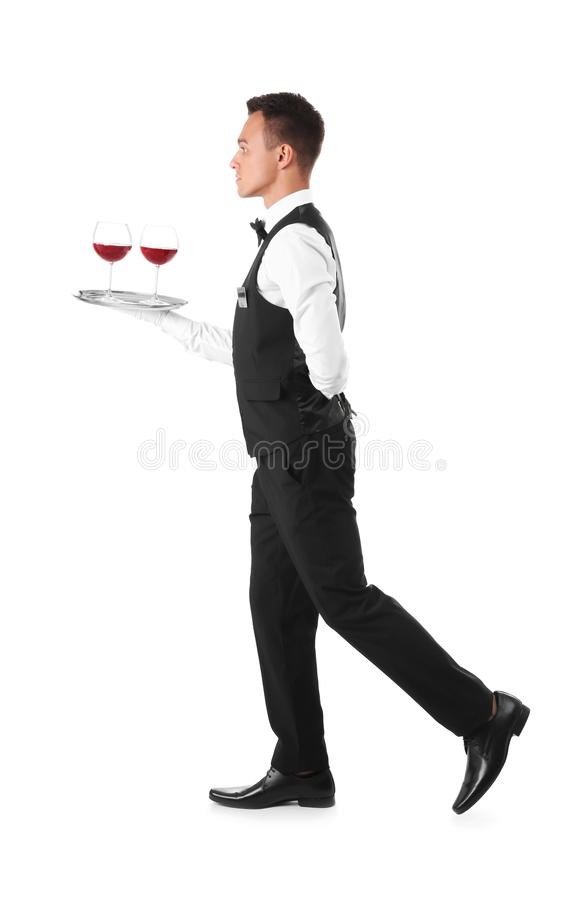 Waiter holding metal tray with glasses of wine royalty free stock images