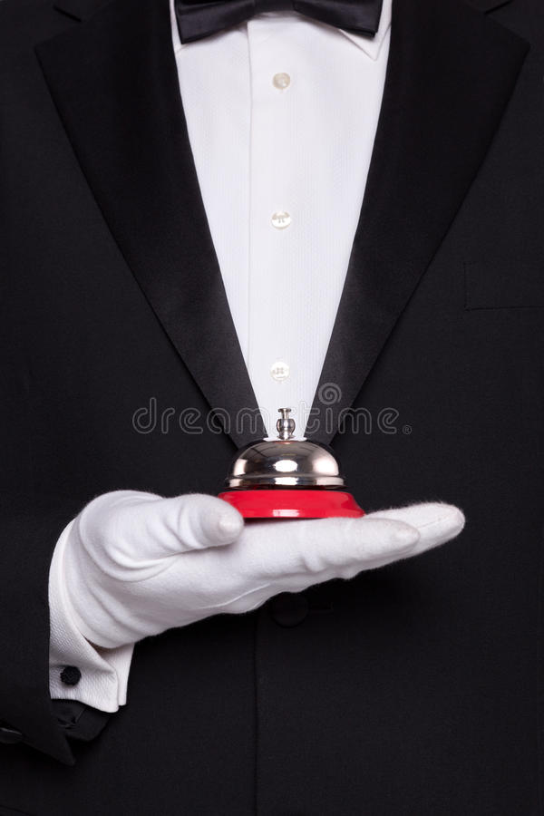 Waiter holding a service bell. royalty free stock photos