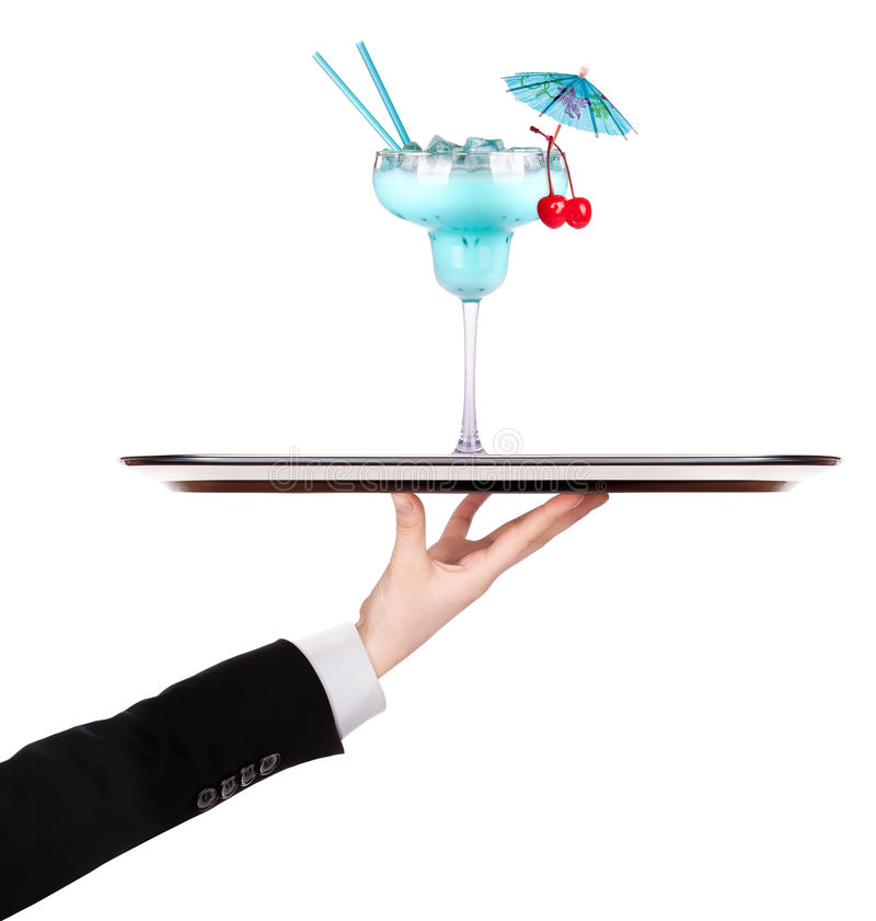 Waiter holding silver tray with cocktail royalty free stock photography