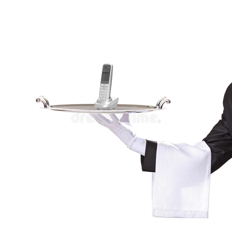 Waiter holding a tray with a phone on it stock photo