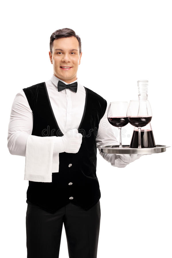 Waiter holding a tray with red wine stock images