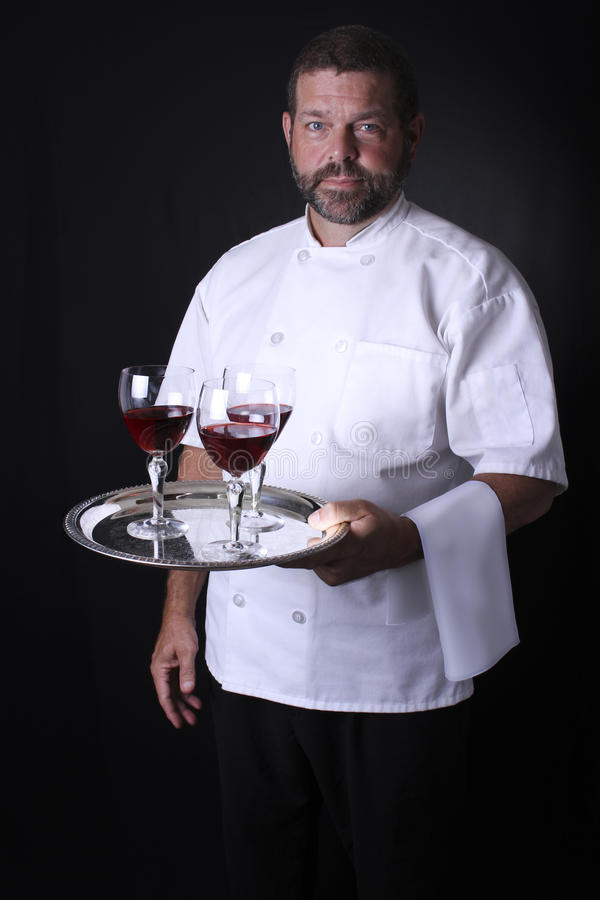 Download A Waiter Holding A Tray Of Wine Glasses. Stock Photo - Image: 29143228