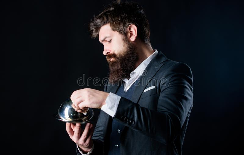 Waiter luxury restaurant. Man well groomed gentleman formal suit hold little cloche. Serving and presentation. Elite stock photos