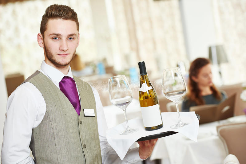 Waiter man in restaurant royalty free stock photo