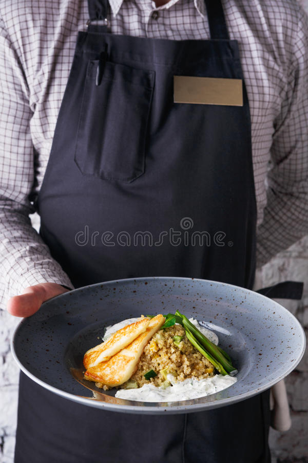 Waiter offering delicious restaurant dish royalty free stock photo