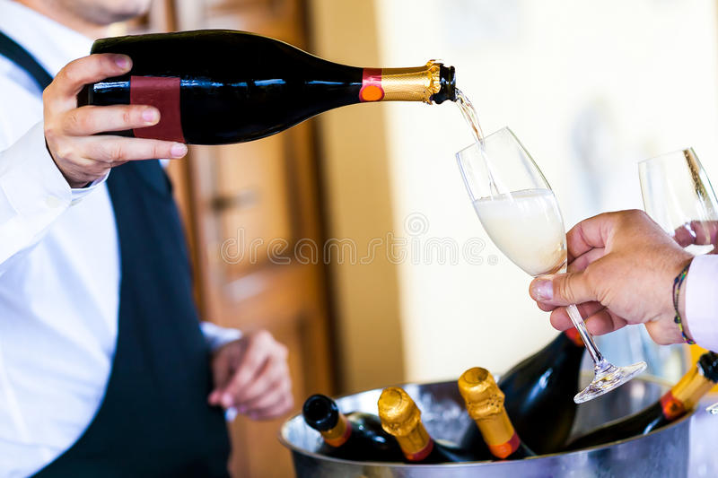 Waiter pouring champagne royalty free stock image