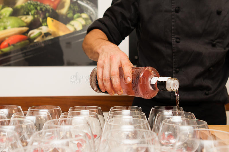 Waiter pouring gin royalty free stock images