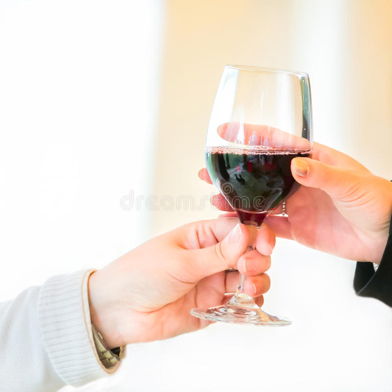 Waiter pouring red wine royalty free stock photo