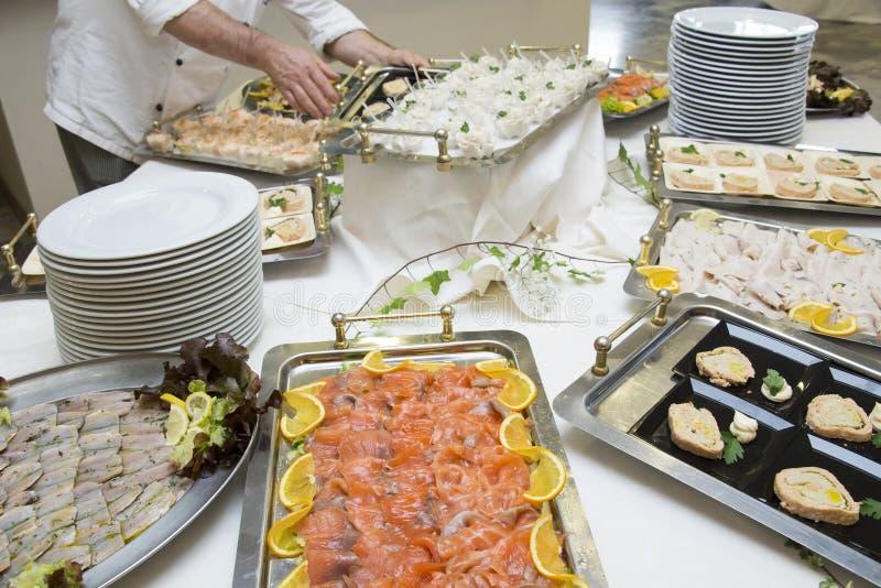 Waiter preparing wedding buffet royalty free stock photos