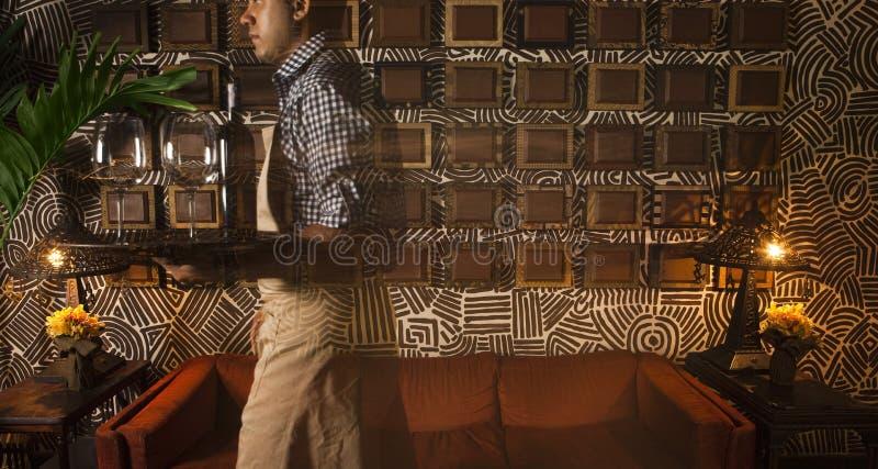 Waiter In A Restaurant Editorial Photo