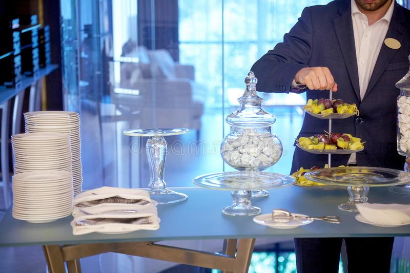 The waiter serving table royalty free stock image