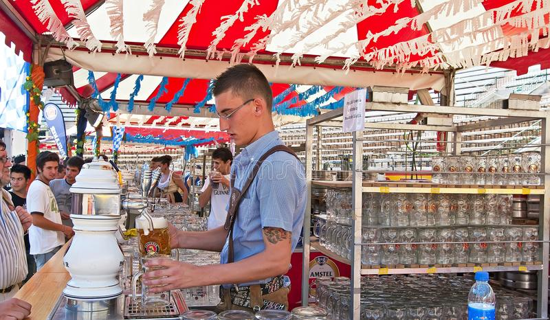 Waiter serving beer at the Oktoberfest stock photo