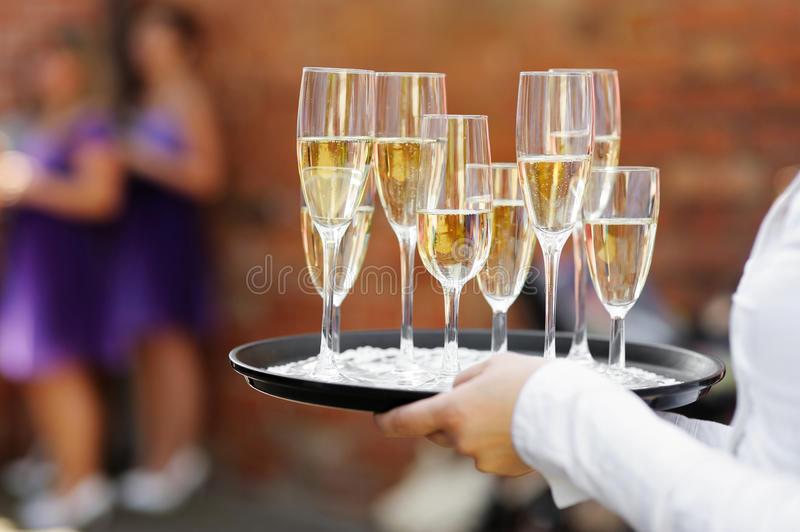 Waiter Serving Champagne Stock Photography