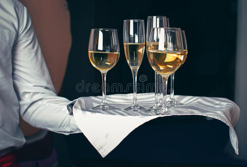 Waiter serving champagne on tray royalty free stock images