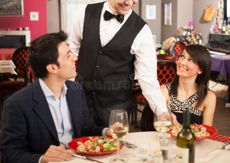 Waiter serving sea food stock photo