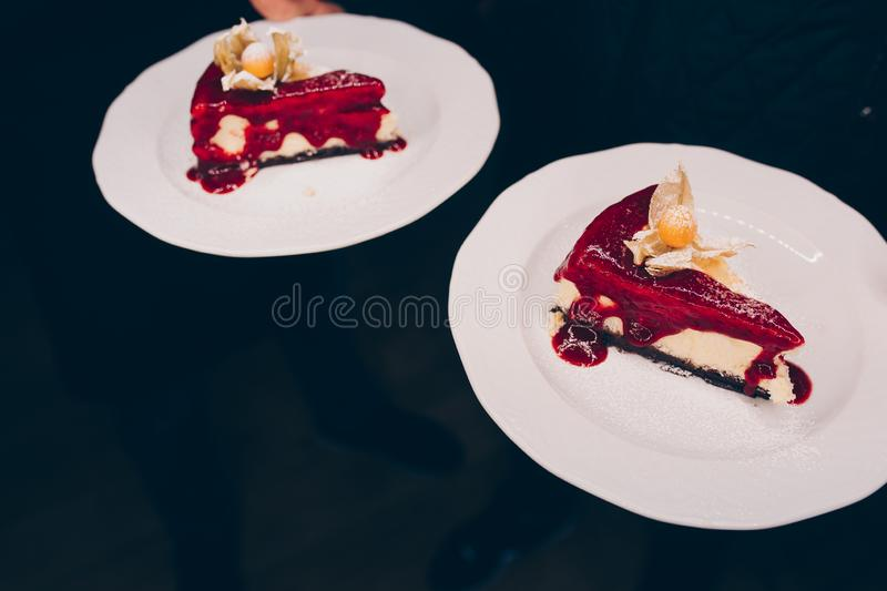 Waiter serving tray with delicious  tasty  Coffee expresso , close up view. dessert cuisine tart holding Pancake in cafe menu.Past royalty free stock photography