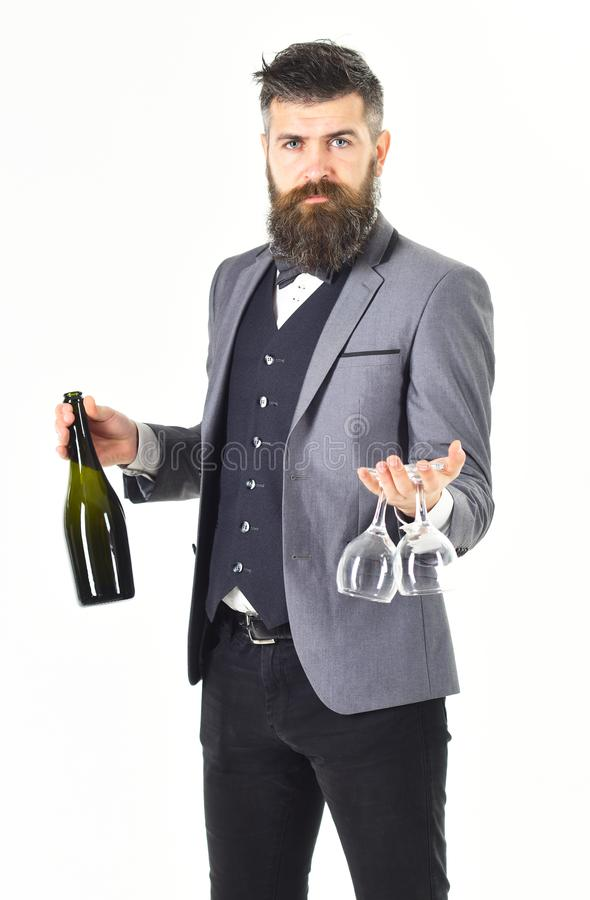 Waiter sommelier with bottle of red wine stock image