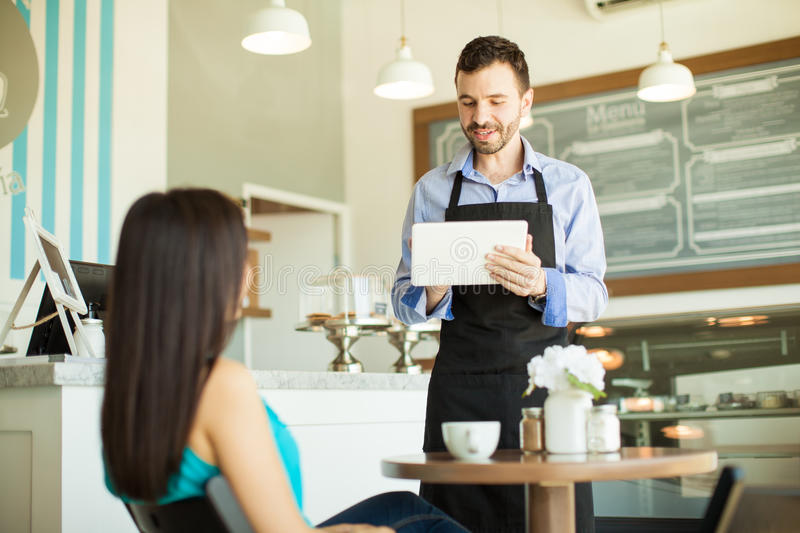 Waiter taking order with a tablet royalty free stock photography