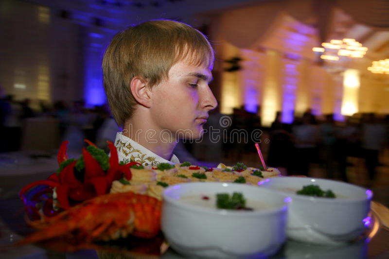 The waiter with the tray in a Russian restaurant. royalty free stock photography