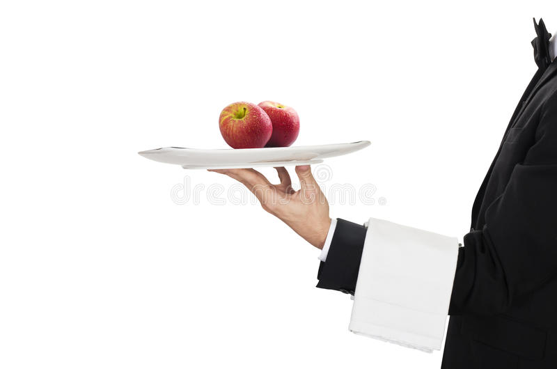 Waiter with two red apples stock photography