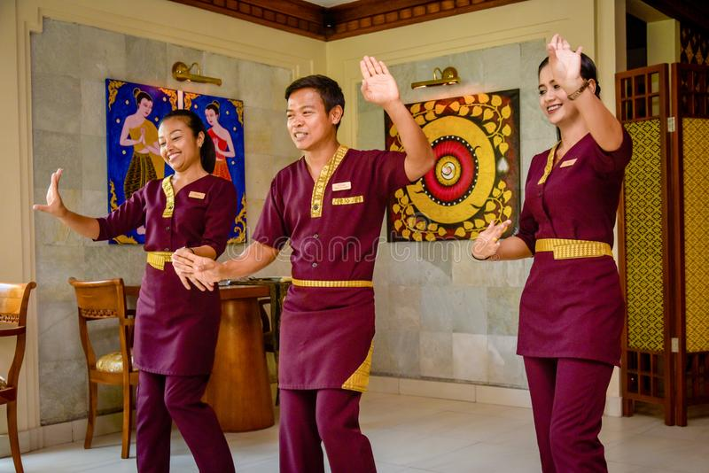 Waiter and waitress in the thai restaurant dancing stock photography