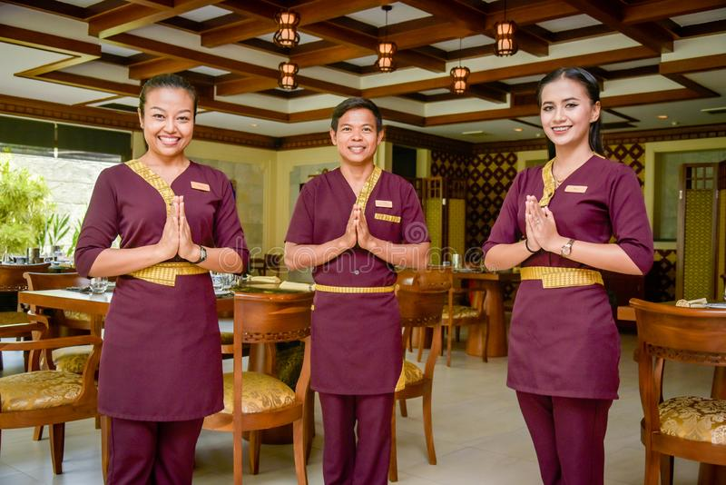 Waiter and waitress in the thai restaurant standing and smiling stock photos
