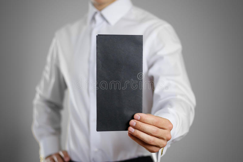 A waiter in the white shirt holding blank clear black of the she royalty free stock images