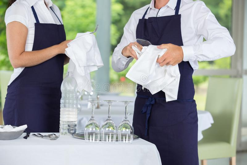 Waiters cleaning glasses in restaurant. Waiters cleaning glasses in a restaurant stock image