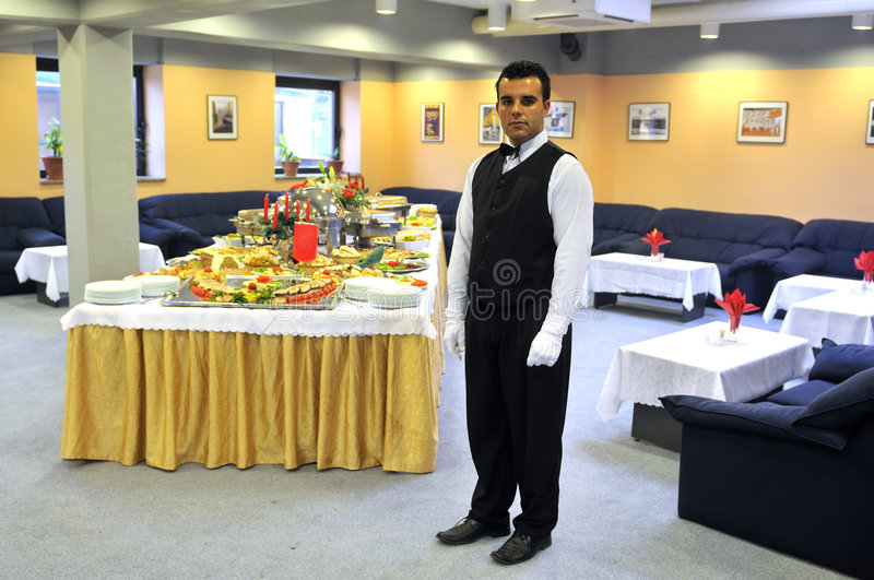 Waiters in a luxery hotel. YOung Waiter in a luxery hotel royalty free stock image