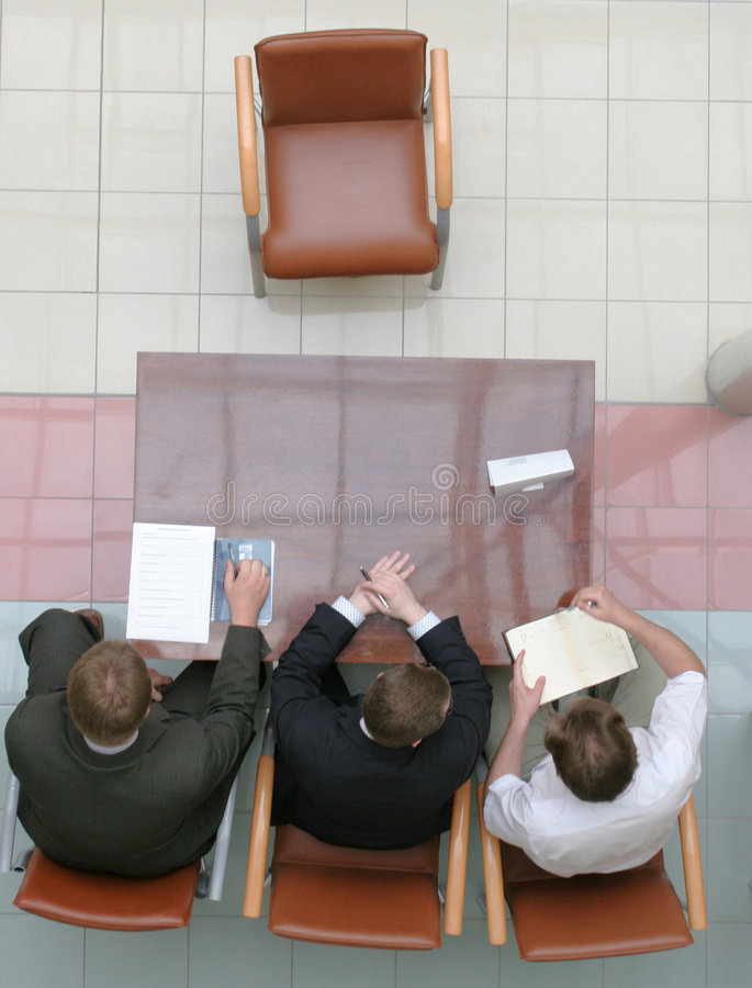 Waiting for applicant. Three professionals waiting for applicant stock image