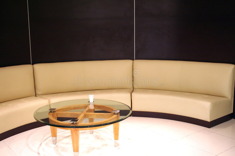 Waiting area. Corporate waiting area, tanned leather sofa in a curve stock photos