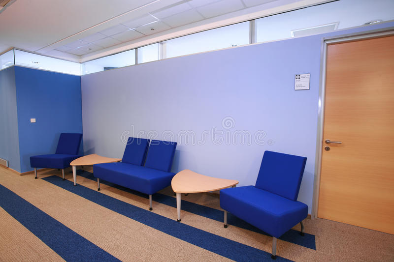 Waiting area. Detail of a blue waiting area from a office building stock photo