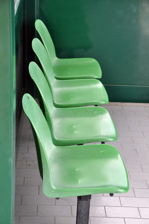 Waiting Area Chairs. Row of green chairs in waiting area royalty free stock photography