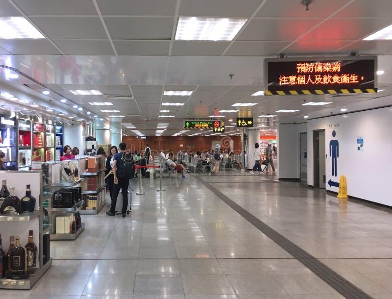 Waiting area at Hong Kong Macau Ferry Terminal. HONG KONG - SEPT 2017: Waiting area with duty free shops at the Hong Kong Macau Ferry Terminal. It is also known stock photo