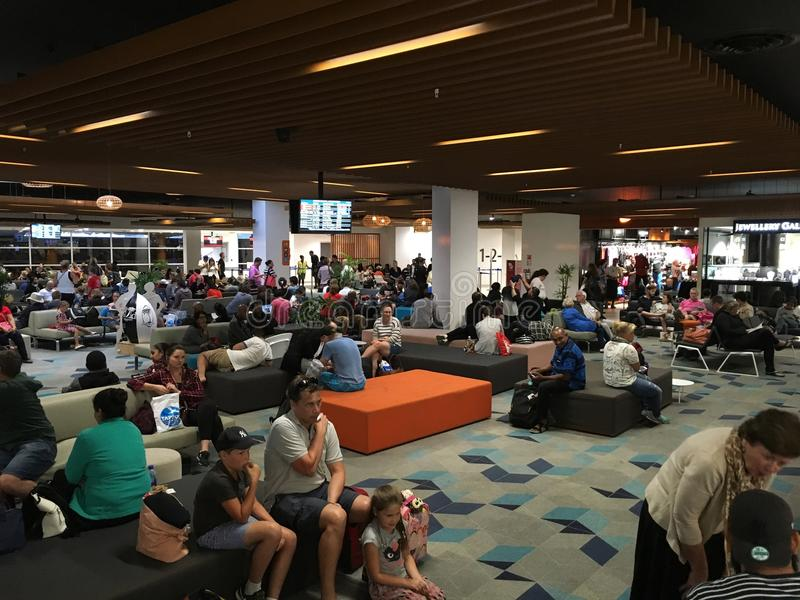 Waiting Area of Nadi International Airport. Fiji after immigration custom check with many passengers waiting and having meals royalty free stock photography
