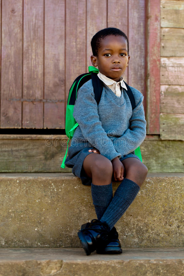 Waiting for the bus. Sitting on the steps and waiting to go to school stock image