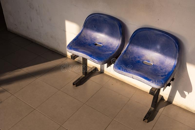 Waiting chair in front of the public toilet. Icon, modern, symbol, sign, people, room, service, transportation, station, business, design, travel, lady royalty free stock photography