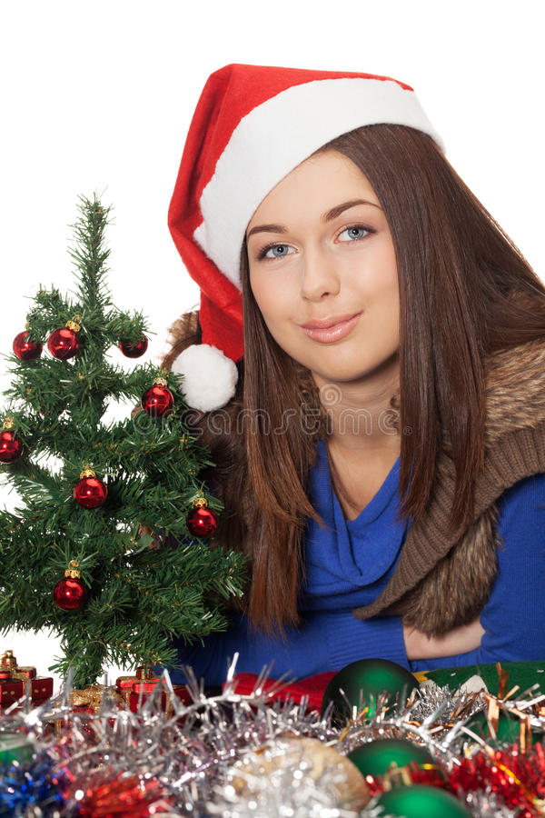 Waiting for Christmas to come. Smiling girl in santa hat is waiting for the Christmas to come stock photo