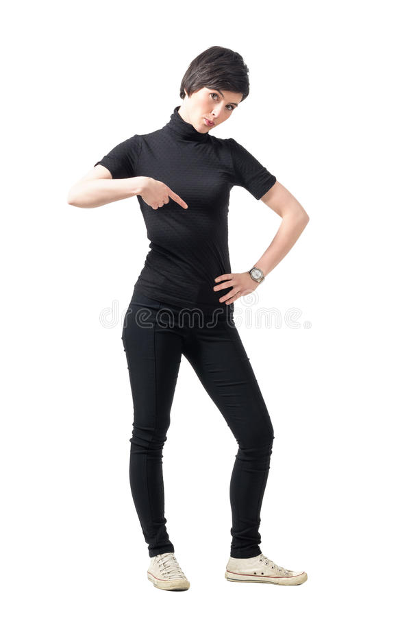 Waiting concept. Young unhappy woman pointing at wrist watch looking at camera stock image