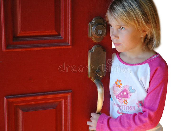 Waiting by the door. Young girl waits by the door for someone stock images