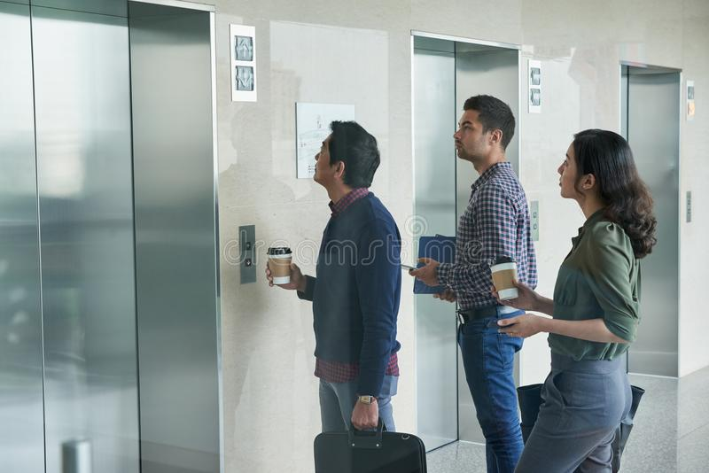 Waiting for elevator. Business people waiting for elevator in office hall royalty free stock photography