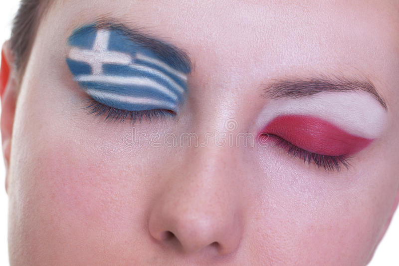 Waiting for exciting match, group A. Young girl is dreaming about score in match between Greece and Poland: EURO 2012, group A, 8th of June. Focus on eyelashes stock image