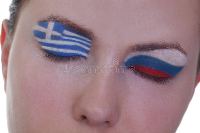 Waiting for exciting match, group A. Young girl is dreaming about score in match between Greece and Russia: EURO 2012, group A, 16th of June. Focus on eyelashes royalty free stock images