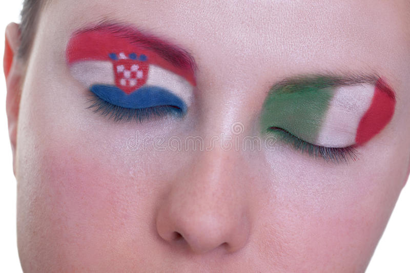 Waiting for exciting match, group C. Young girl is dreaming about score in match between Croatia and Italy: EURO 2012, group C, 14th of June. Focus on eyelashes royalty free stock photos