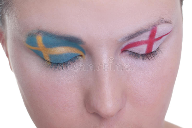 Waiting for exciting match, group D. Young girl is dreaming about score in match between Sweden and Ukraine: EURO 2012, group D, 15th of June. Focus on eyelashes royalty free stock photo
