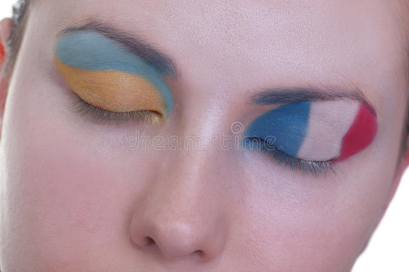 Waiting for exciting match, group D. Young girl is dreaming about score in match between France and Ukraine: EURO 2012, group D, 15th of June. Focus on eyelashes royalty free stock images