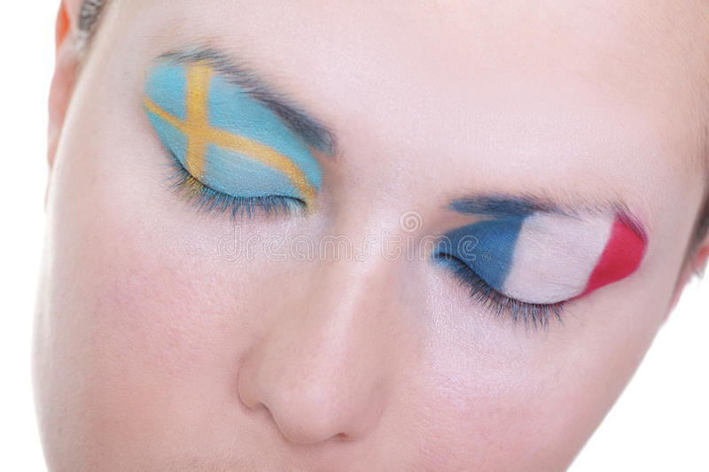Waiting for exciting match, group D. Young girl is dreaming about score in match between Sweden and France: EURO 2012, group D, 19th of June. Focus on eyelashes stock photography